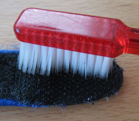 Brush, Red, Lipstick, Chemical compound, Natural material, Personal care, Household supply,