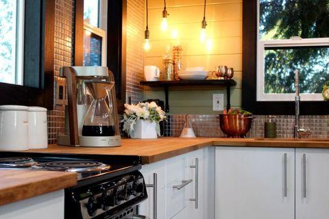Lighting, Gas stove, Room, Small appliance, Kitchen appliance, Interior design, Major appliance, Countertop, Kitchen, Kitchen stove,