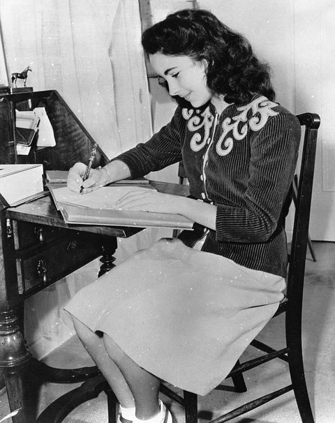 <p>At her writing desk in 1945. </p>