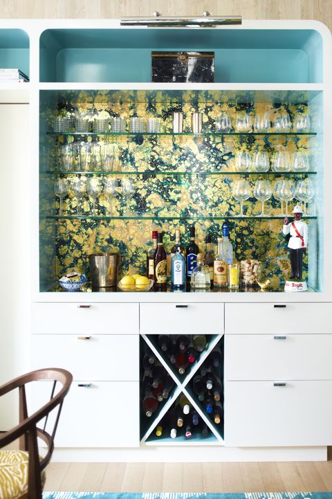 Stark's China Lack wallpaper adds a chic note to a built-in bar unit,