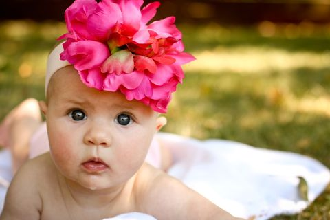 Skin, Petal, Pink, Flower, Hair accessory, Child, People in nature, Headgear, Fashion accessory, Headpiece,