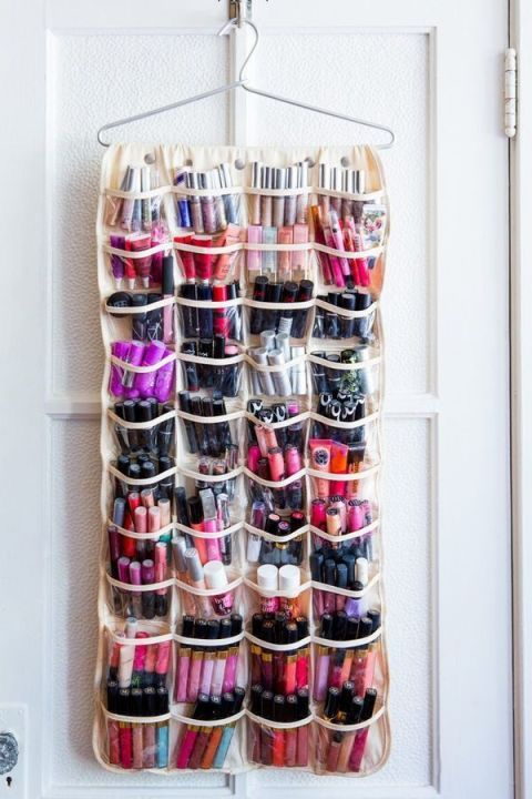 Image result for DIY Hang a shoe bag on the back of your bathroom door and use it to hold things