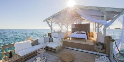 Bed, Couch, Sun, Ocean, Shade, Sunlight, Sea, Bed frame, Living room, Home,