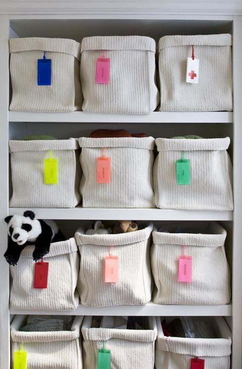 Textile, Panda, Rectangle, Shelving, Stuffed toy, Toy, Collection, Wool, Thread, Shelf,