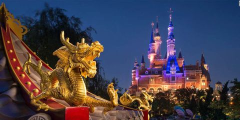 Walt disney world, Sculpture, Landmark, Spire, World, Amusement park, Tourist attraction, Temple, Statue, Turret,
