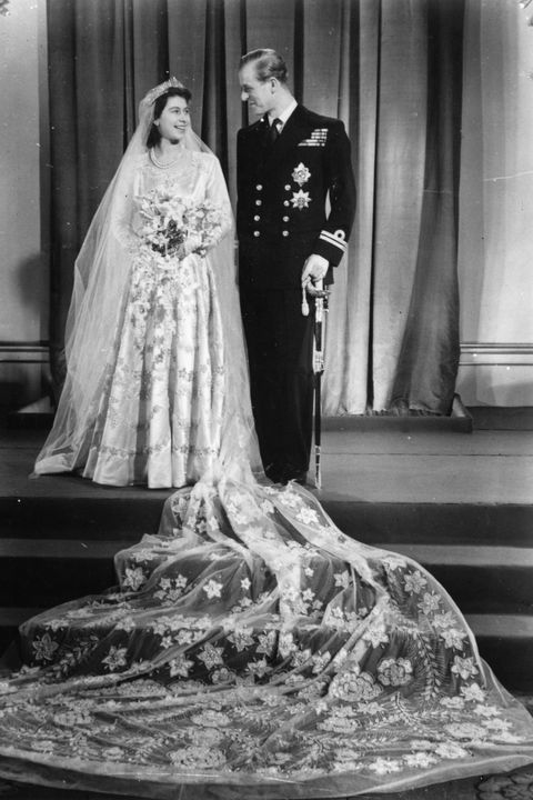20th November 1947:  Princess Elizabeth with Philip Mountbatten on their wedding day.  (Photo by Topical Press Agency/Getty Images)
