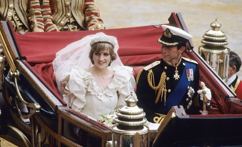 Diana, Princess of Wales and Prince Charles ride in a carriage after their wedding at St. Paul's Cathedral July 29, 1981 in London, England. (Photo by Anwar Hussein/WireImage)
