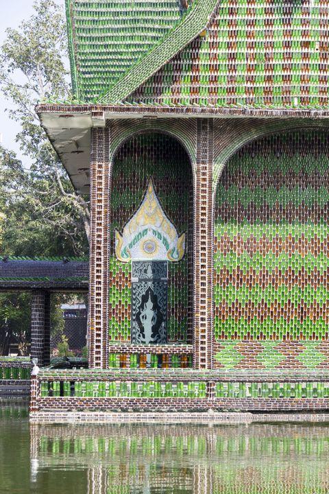 green buildings beer bottle temple