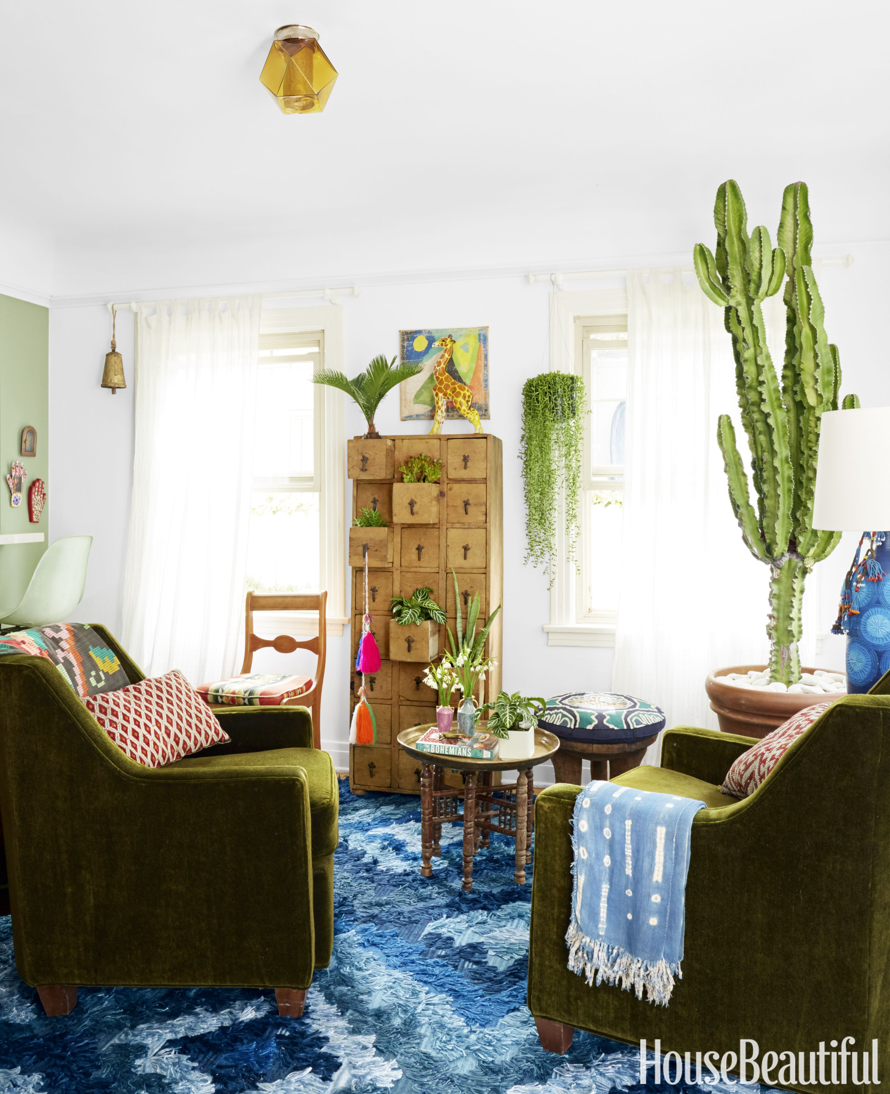 The Living Room Is Anchored By A Tall Euphorbia Plant, Which Is Similar To A