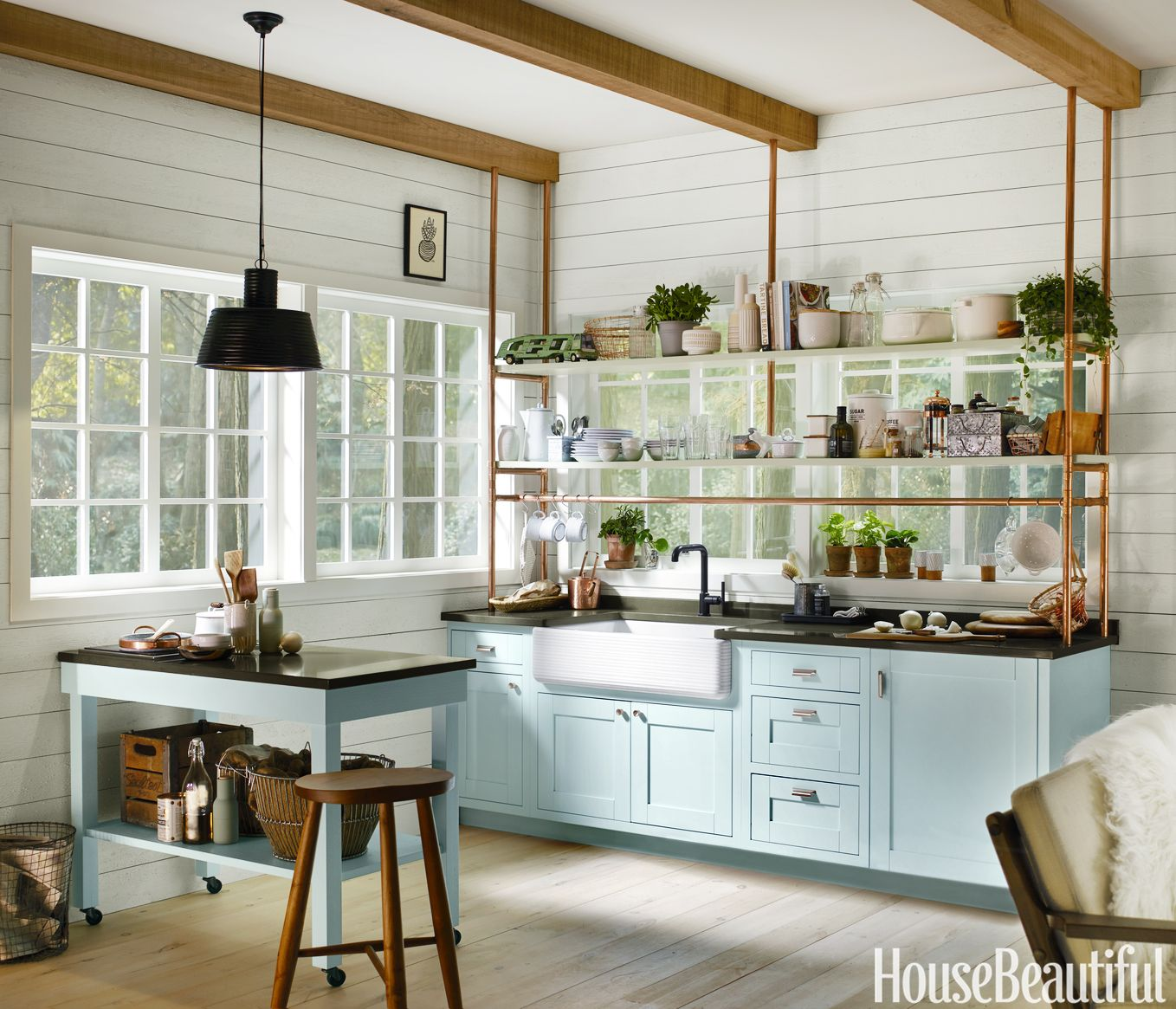 small light blue kitchen with deep sink