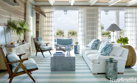 "The living room's raw-poplar walls give the feel of ""a fisherman's shack,"" Watson says. A sofa by Lee Industries is upholstered in Manuel Canovas's Cruz, with pillows in an Amanda Nisbet silk. The Hollywood at Home armchairs have cushions in a fabric from Jerry Pair."