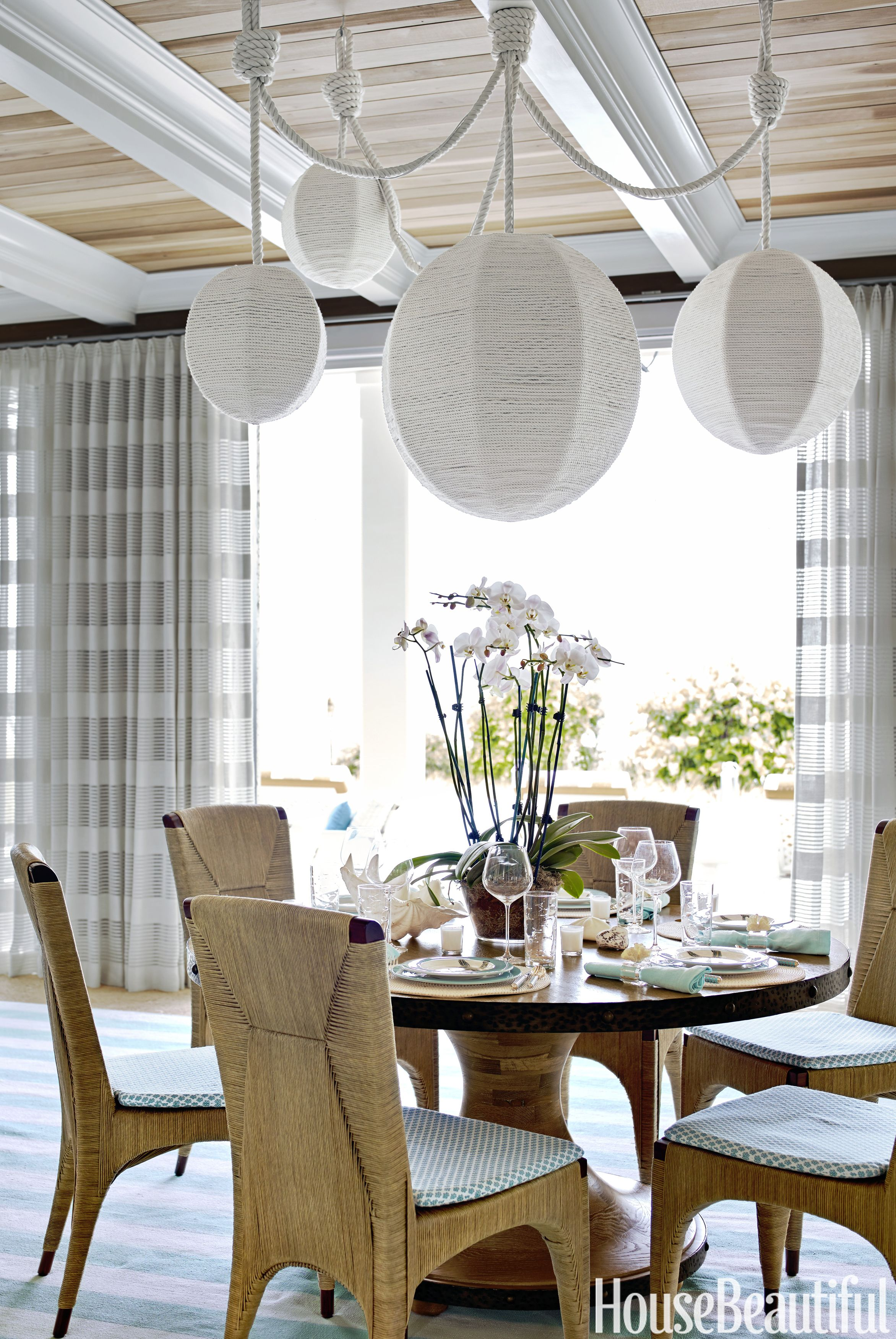 In The Dining Area, A Sedgwick U0026 Brattle Rope Wrapped Chandelier Hangs Over  A