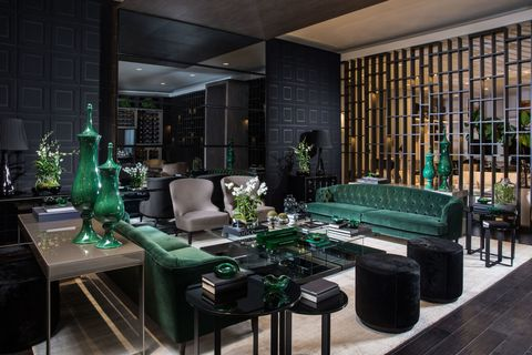 <p>Avant Design, made up of sisters Cristina and Monica Souza, created a space around Tom Ford that  epitomizes the designer's aesthetic with a rich emerald and black color palette. Added velvet pieces provide an element of luxe that is synonymous to Ford.</p>