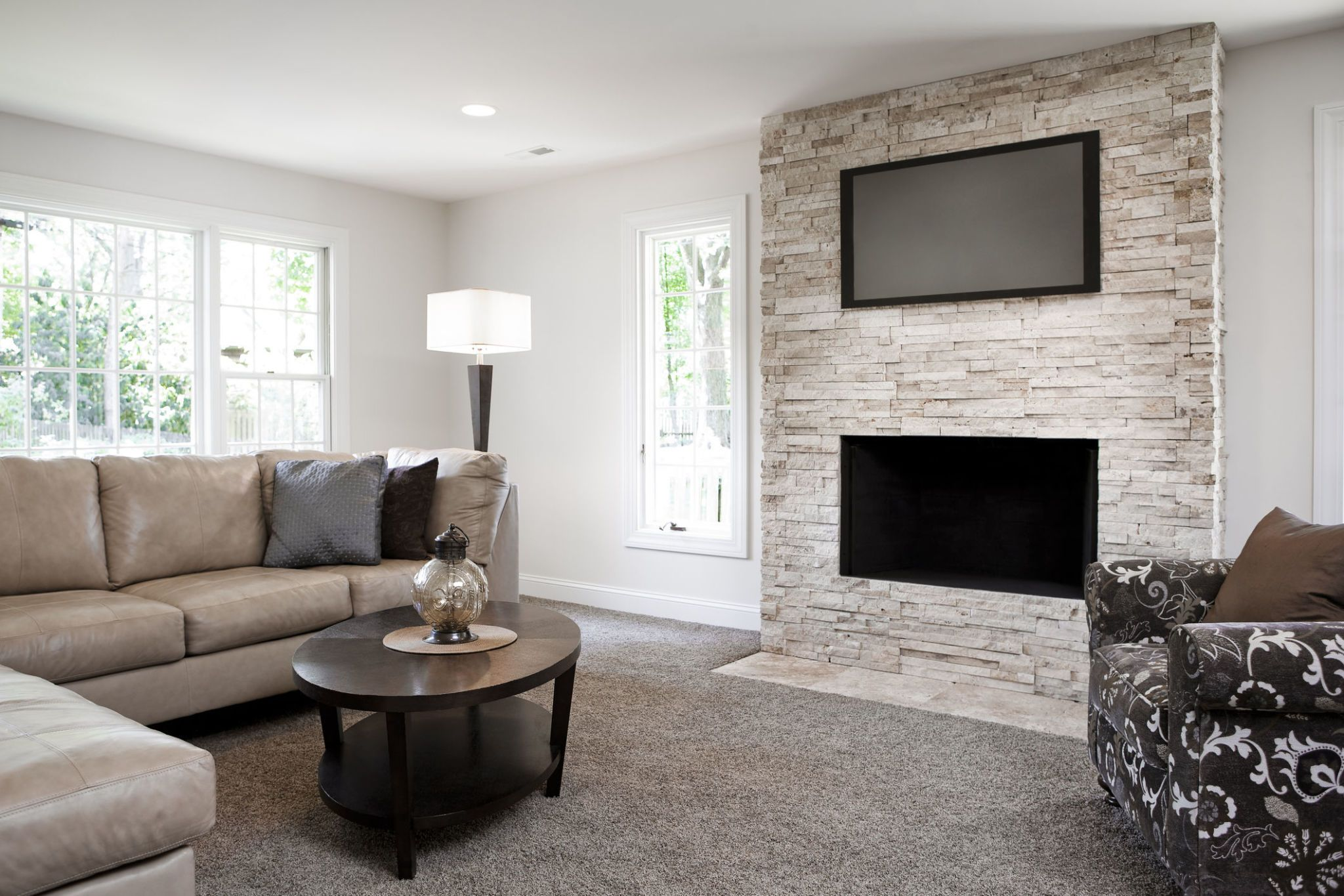 stop hanging your television over your fireplace rh housebeautiful com living room with fireplace and tv layout living room with fireplace and tv on opposite walls
