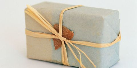 Textile, Tan, Khaki, Beige, Paper product, Present, Gift wrapping, Packing materials, Label, Party favor,