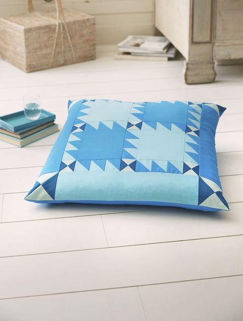 quilted blue cushion