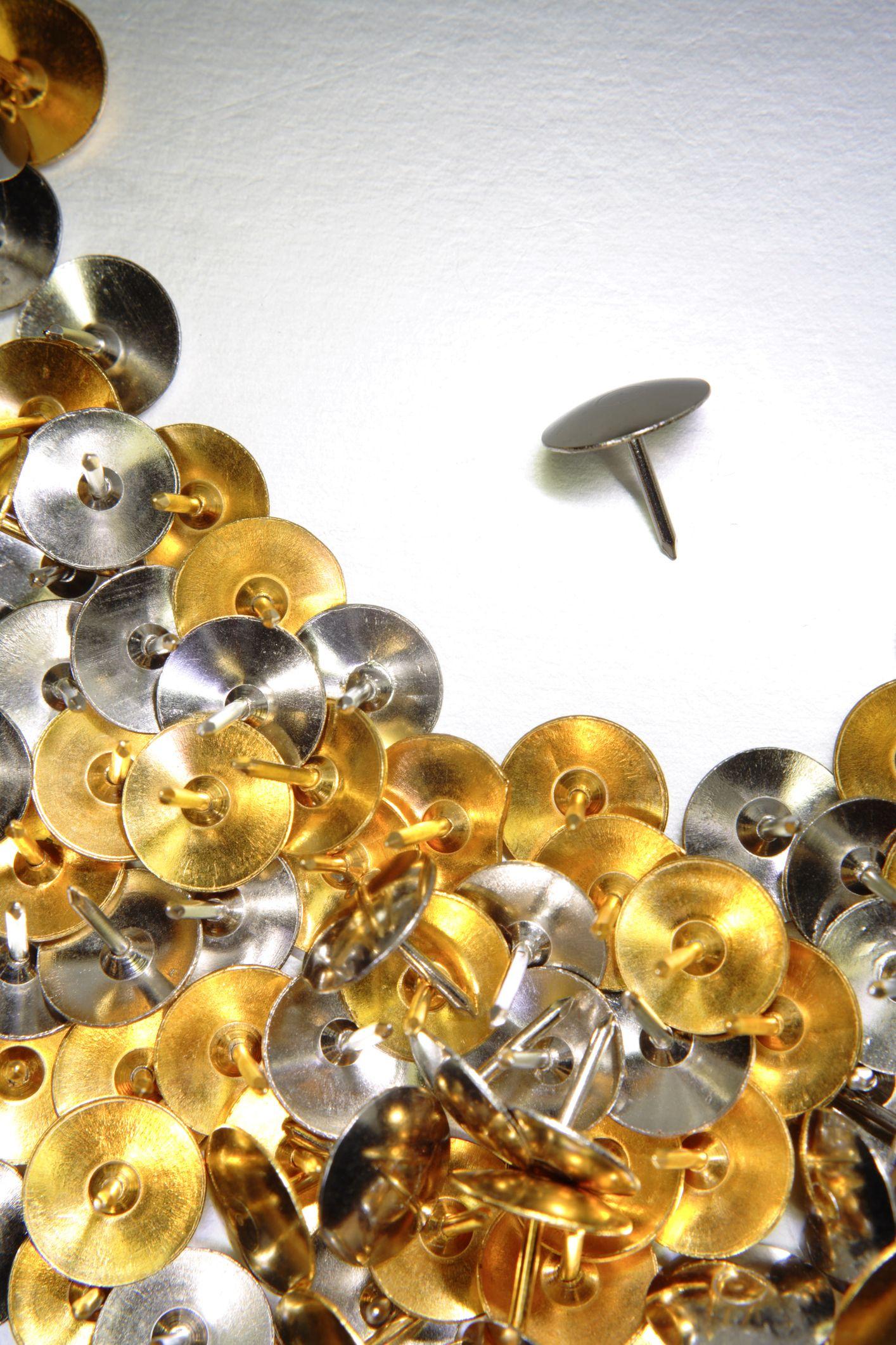 gold and silver thumbtacks