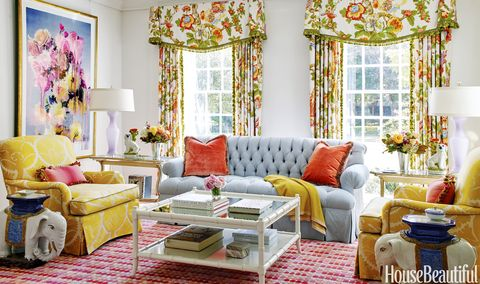 McCarthy injected playfulness with curtains in a GP & J Baker fabric, a custom sofa in a Scalamandré stripe, 1950s Italian glass lamps from Jan Showersand vintage elephant garden stools turned accent tables.