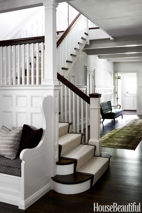 white entryway with built in bench