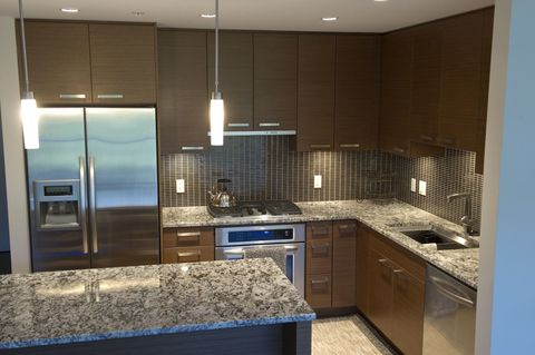 Countertop, Cabinetry, Room, Property, Kitchen, Furniture, Tile, Interior design, Lighting, Building,