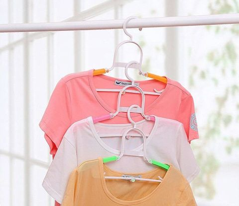 Clothes hanger, White, Clothing, Pink, Product, Orange, Yellow, Peach, Outerwear, Child,