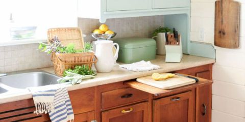 Countertop, Furniture, Room, Kitchen, Property, Cabinetry, Table, Yellow, Shelf, Interior design,