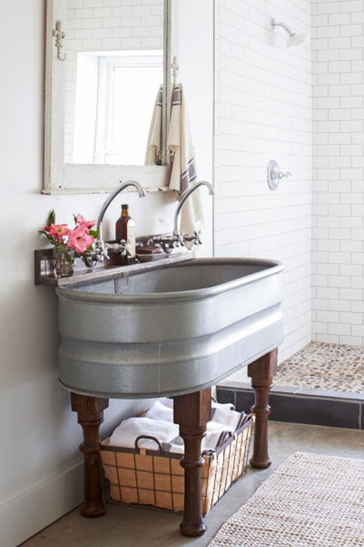 "<p>Take a cue from this homeowner and upcycle a large tub to make a double sink, or use a small tank for a teeny bathroom.</p><p><strong data-redactor-tag=""strong"" data-verified=""redactor"">See more ideas from <a href=""http://www.countryliving.com/home-design/house-tours/g2545/leipers-fork-tennessee-cabin/"" target=""_blank"" data-tracking-id=""recirc-text-link"">this rustic cabin in Tennessee</a>.</strong></p>"