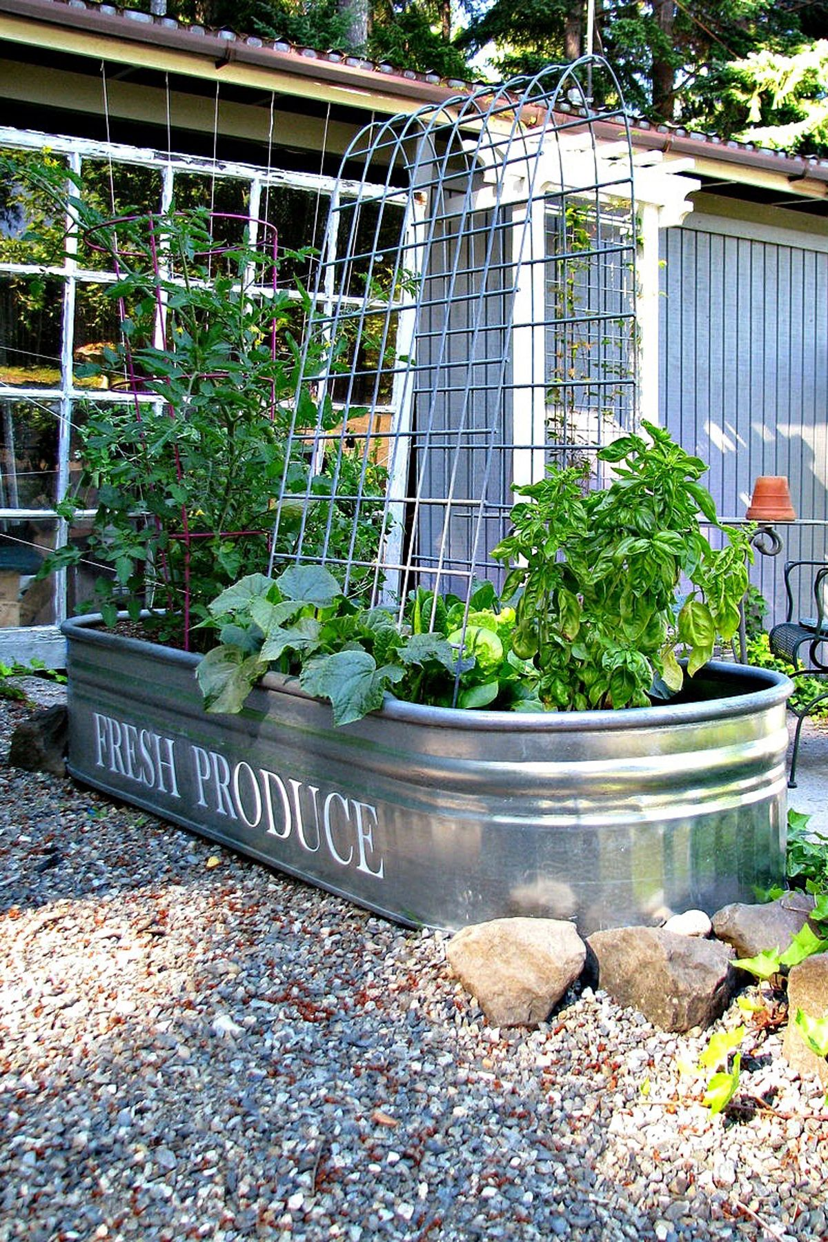"<p>Does a big sprawling garden sound unmanageable? Keep things contained and compact by using a galvanized feed trough as a raised gardening bed.</p><p><strong data-redactor-tag=""strong"" data-verified=""redactor"">Get the tutorial at <a href=""http://www.blueroofcabin.com/2014/06/a-managable-veggie-garden.html"" target=""_blank"" data-tracking-id=""recirc-text-link"">Blue Roof Cabin</a><span class=""redactor-invisible-space"" data-verified=""redactor"" data-redactor-tag=""span"" data-redactor-class=""redactor-invisible-space"">.</span></strong></p>"