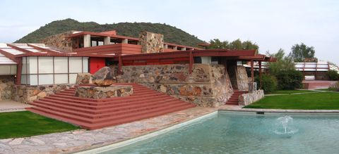 "<p><span>Considered one of America's finest architects of all time, Frank Lloyd Wright place what's possibly his most personal design, his desert home&nbsp;Taliesin West<span class=""redactor-invisible-space""></span>&nbsp;in the McDowell Mountains of Scottsdale, Arizona. Started in 1937, the&nbsp;homestead was built up over years by Wright and his architectural students—they still come to work at the site—and handcrafted with desert masonry of local volcanic rock, cement mixed with desert sand,&nbsp;and redwood beams that open to the light. Wright's aim was to embrace the nature around him, build with local materials, and then connect the architecture through terraces, pools, and gardens.</span><br></p>"