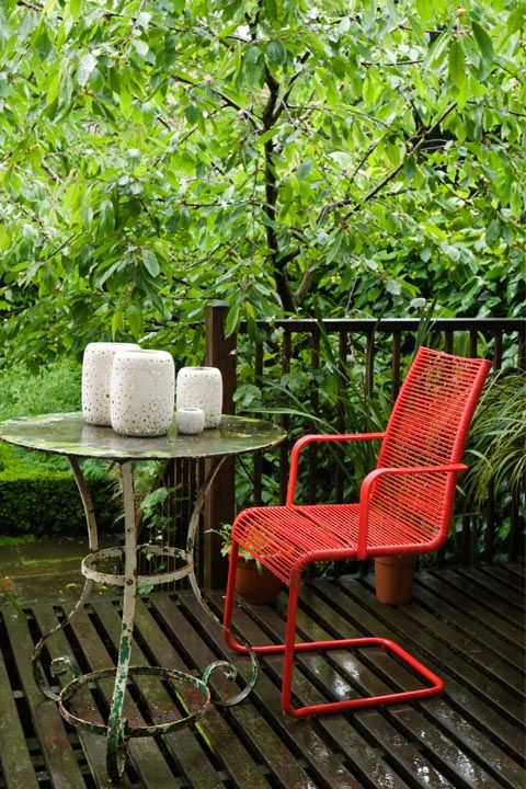 Chair, Furniture, Outdoor furniture, Table, Tree, Armrest, Outdoor table, Folding chair, House, Patio,