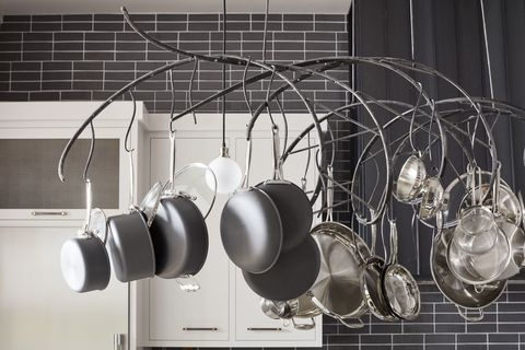 "<p>When a space has tall ceilings, you need a little drama up high, too.&nbsp&#x3B;Partnering with an artisan, de la Cruz&nbsp&#x3B;designed the custom rack for&nbsp&#x3B;maximum convenience — each pot is hung with&nbsp&#x3B;its&nbsp&#x3B;lid, so no need to dig through cabinets for its mates. Polished nickel globe bulbs&nbsp&#x3B;by&nbsp&#x3B;<a href=""http://www.troy-lighting.com/"" target=""_blank"">Troy Lighting</a>&nbsp&#x3B;intermingle&nbsp&#x3B;for additional lighting, a must over an active prep space.<span class=""redactor-invisible-space"" data-verified=""redactor"" data-redactor-tag=""span"" data-redactor-class=""redactor-invisible-space""></span></p>"