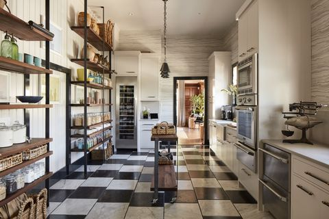 "<p>The color scheme that runs throughout, beginning with the Versailles-inspired black and white <a href=""http://www.allnaturalstoneinc.com/prepress_portfolio/haussmann/"" target=""_blank"">Hausmann</a> tile, nods to the San Francisco home's history:&nbsp&#x3B;""The intent was for a classic black and white kitchen, like sea salt and black pepper.&nbsp&#x3B;I chose Cornforth White and Off Black from <a href=""http://us.farrow-ball.com/"" target=""_blank"">Farrow and Ball</a>&nbsp&#x3B;for the walls,&nbsp&#x3B;which gives the timeless combination a slight patina that fit the&nbsp&#x3B;100-year-old&nbsp&#x3B;house,"" says de La Cruz.<span class=""redactor-invisible-space"" data-verified=""redactor"" data-redactor-tag=""span"" data-redactor-class=""redactor-invisible-space"" style=""background-color: initial&#x3B;"" rel=""background-color: initial&#x3B;"" data-redactor-style=""background-color: initial&#x3B;"">&nbsp&#x3B;Look closely and you'll see the tiles are set off-center, which makes&nbsp&#x3B;the room&nbsp&#x3B;feel&nbsp&#x3B;more casual.</span></p>"