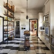 """<p>The color scheme that runs throughout, beginning with the Versailles-inspired black and white <a href=""""http://www.allnaturalstoneinc.com/prepress_portfolio/haussmann/"""" target=""""_blank"""">Hausmann</a> tile, nods to the San Francisco home's history:&nbsp;""""The intent was for a classic black and white kitchen, like sea salt and black pepper.&nbsp;I chose Cornforth White and Off Black from <a href=""""http://us.farrow-ball.com/"""" target=""""_blank"""">Farrow and Ball</a>&nbsp;for the walls,&nbsp;which gives the timeless combination a slight patina that fit the&nbsp;100-year-old&nbsp;house,"""" says de La Cruz.<span class=""""redactor-invisible-space"""" data-verified=""""redactor"""" data-redactor-tag=""""span"""" data-redactor-class=""""redactor-invisible-space"""" style=""""background-color: initial;"""" rel=""""background-color: initial;"""" data-redactor-style=""""background-color: initial;"""">&nbsp;Look closely and you'll see the tiles are set off-center, which makes&nbsp;the room&nbsp;feel&nbsp;more casual.</span></p>"""