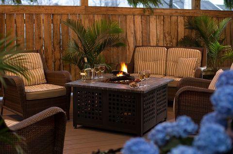 Furniture, Wicker, Lighting, Patio, Room, Deck, Coffee table, Home, Backyard, Table,