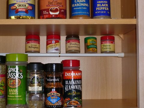 Brown, Ingredient, Logo, Condiment, Food storage containers, Shelf, Shelving, Food storage, Bottle, Pantry,