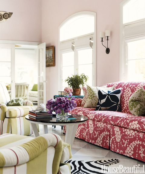 living room with patterns and pink walls