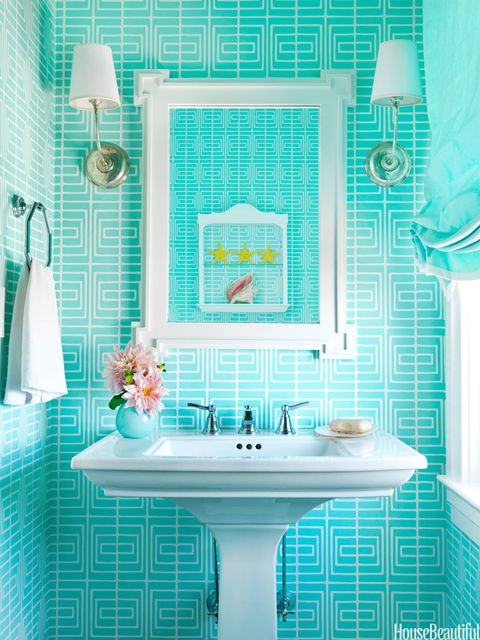 bath with bright blue wall covering