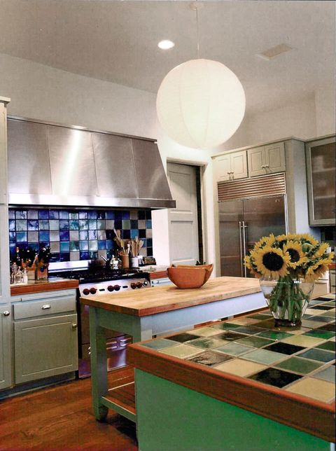 green and blue tiled kitchen