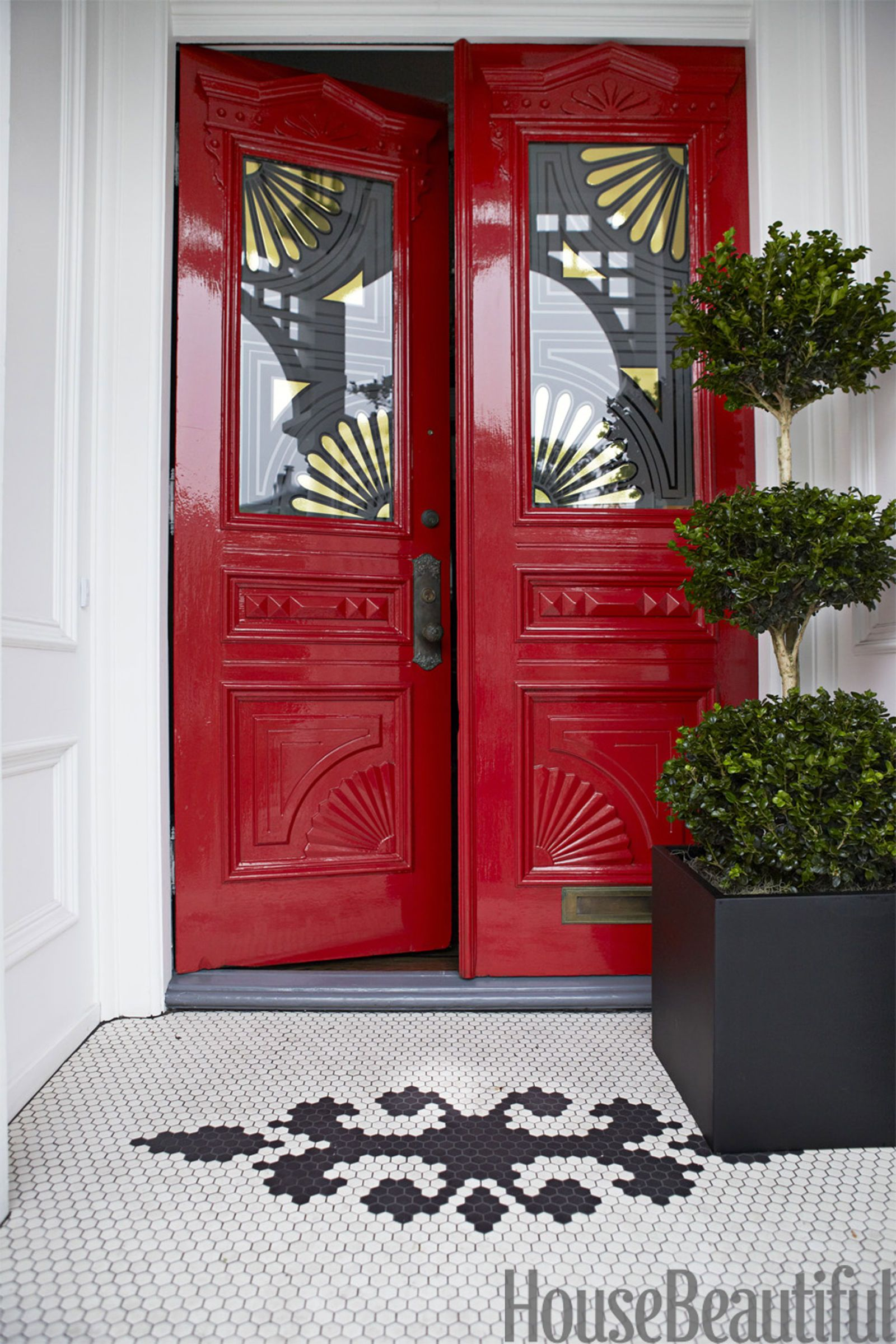 red front door with gold motif on glass