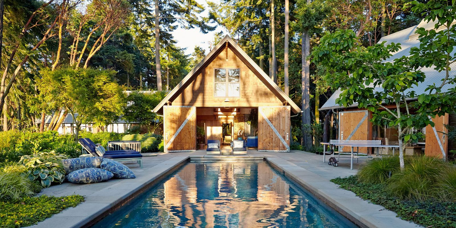 ... An All Natural Swimming Pond, These Designer Pools Make A Splash. Steal  Our Favorite Patio And Landscaping Ideas Too For The Ultimate Backyard  Getaway.