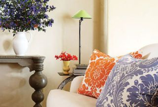 white sofa with bright pillows