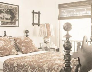 guest bedroom with antique cannonball bed