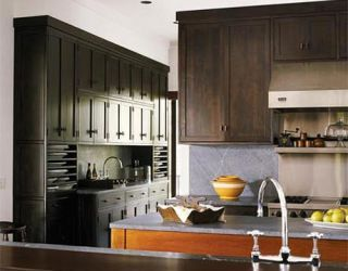 kitchen with gray soapstone island top and dark cabinets