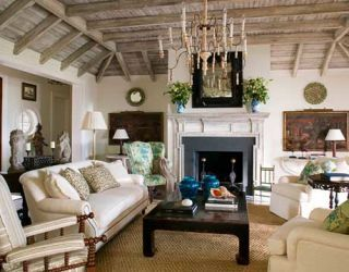 seating arrangement is grouped around the fireplace.