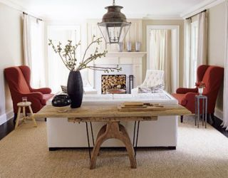 white living room with red chairs