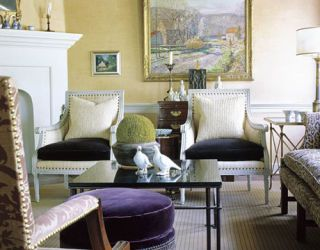 yellow living room with purple ottoman