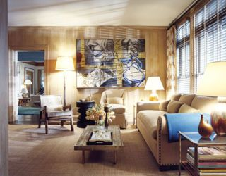 paneled library with blue accents and large painting