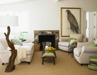 living room with eagle painting and branch floor lamp