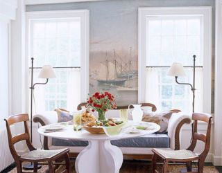 dining room with ship wallpaper