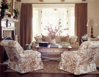 living room with sofa and chairs